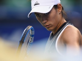 TOKYO, JAPAN - SEPTEMBER 20:  Garbine Muguruza of Spain looks on prior to her match against Monica Puig of Puerto Rico during day three of the Toray Pan Pacific Open Tennis At Ariake Coliseum on September 20, 2017 in Tokyo, Japan.  (Photo by Matt Roberts/Getty Images)
