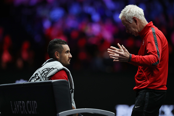 PRAGUE, CZECH REPUBLIC - SEPTEMBER 24:  John Mcenroe, Captain of Team World and Nick Kyrgios of Team World during his mens singles match against Roger Federer of Team Europe on the final day of the Laver cup on September 24, 2017 in Prague, Czech Republic. The Laver Cup consists of six European players competing against their counterparts from the rest of the World. Europe will be captained by Bjorn Borg and John McEnroe will captain the Rest of the World team. The event runs from 22-24 September.  (Photo by Julian Finney/Getty Images for Laver Cup)