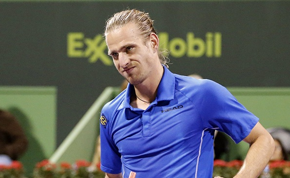 Peter Gojowczyk of Germany reacts during his match against Rafael Nadal of Spain during their Qatar Open tennis match in Doha January 3, 2014. REUTERS/Ahmed Jadallah (QATAR - Tags: SPORT TENNIS)