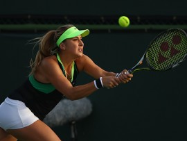 INDIAN WELLS, CA - MARCH 10:  Belinda Bencic of Switzerland plays a backhand against Kiki Bertens of the Netherlands during their second round match on day five of the BNP Paribas Open at Indian Wells Tennis Garden on March 10, 2017 in Indian Wells, California.  (Photo by Clive Brunskill/Getty Images)