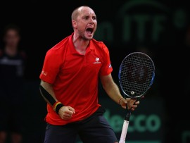 BRUSSELS, BELGIUM - SEPTEMBER 17:  Steve Darcis of Belgium celebrates ater winning the second set against Jordan Thompson of Australia during day three of the Davis Cup World Group semi final match between Belgium and Australia at Palais 12 on September 17, 2017 in Brussels, Belgium.  (Photo by Julian Finney/Getty Images)