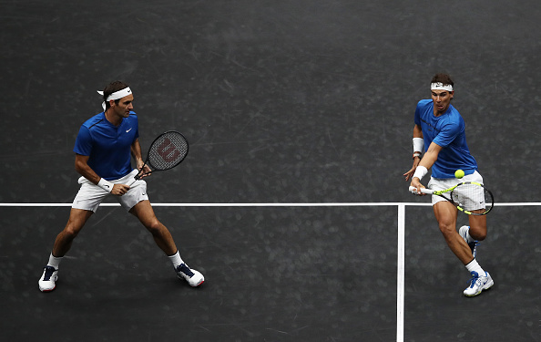 PRAGUE, CZECH REPUBLIC - SEPTEMBER 23: Roger Federer and Rafael Nadal of Team Europe in action during there doubles match against Jack Sock and Sam Querrey of Team World on Day 2 of the Laver Cup on September 23, 2017 in Prague, Czech Republic. The Laver Cup consists of six European players competing against their counterparts from the rest of the World. Europe will be captained by Bjorn Borg and John McEnroe will captain the Rest of the World team. The event runs from 22-24 September. (Photo by Julian Finney/Getty Images for Laver Cup)