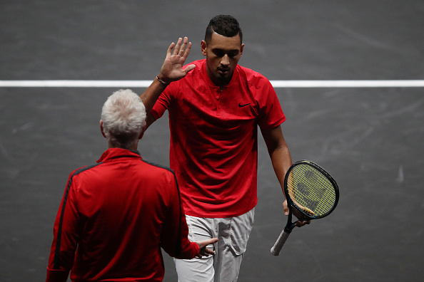 PRAGUE, CZECH REPUBLIC - SEPTEMBER 23:  Nick Kyrgios of Team World greets John Mcenroe, Captain of Team World during his singles match against Tomas Berdych of Team Europe on Day 2 of the Laver Cup on September 23, 2017 in Prague, Czech Republic. The Laver Cup consists of six European players competing against their counterparts from the rest of the World. Europe will be captained by Bjorn Borg and John McEnroe will captain the Rest of the World team. The event runs from 22-24 September.  (Photo by Julian Finney/Getty Images for Laver Cup)