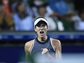 TOKYO, JAPAN - SEPTEMBER 22:  Garbine Muguruza of Spain celebrates in her quarter final match against Caroline Garcia of France during day five of the Toray Pan Pacific Open Tennis At Ariake Coliseum on September 22, 2017 in Tokyo, Japan.  (Photo by Matt Roberts/Getty Images)