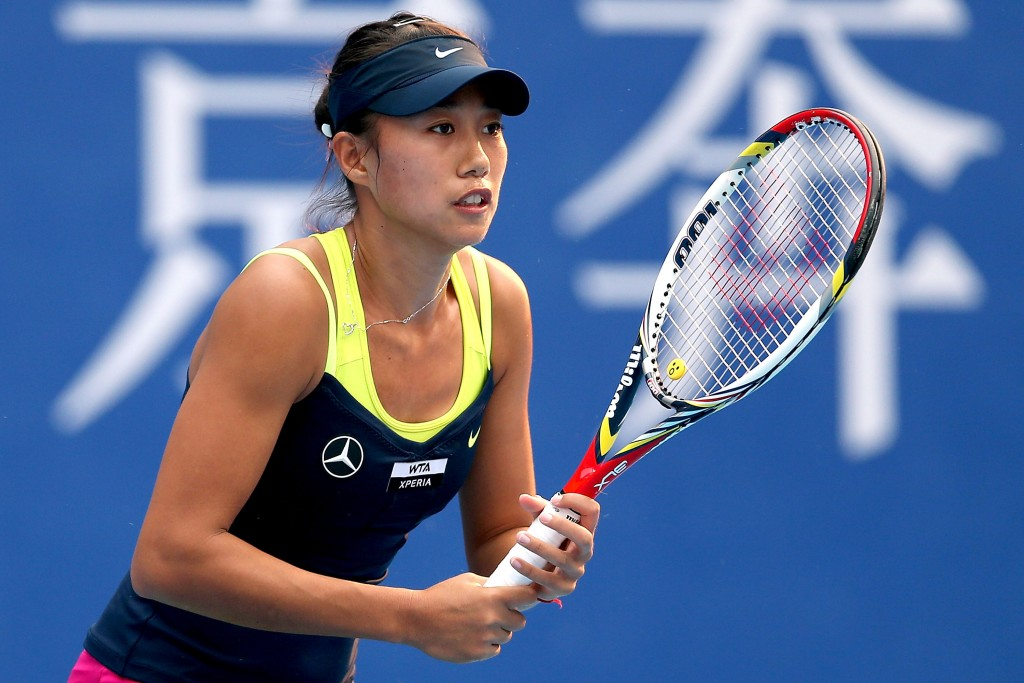 BEIJING, CHINA - OCTOBER 02:  Shuai Zhang of China plays Agnieszka Radwanska of Poland during the China Open at the China National Tennis Center on October 2, 2012 in Beijing, China.  (Photo by Matthew Stockman/Getty Images)