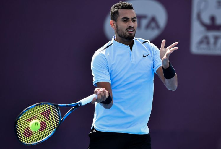 BEIJING, CHINA - OCTOBER 03:  Nick Kyrgios of Australia returns a shot against Nikoloz Basilashvili of Georgia during the men's singles first round on day four of 2017 China Open at the China National Tennis Centre on October 3, 2017 in Beijing, China.  (Photo by Etienne Oliveau/Getty Images)