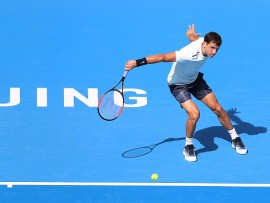 BEIJING, CHINA - OCTOBER 03:  Grigor Dimitrov of Bulgaria returns a shot against Damir Dzumhur of Bosnia and Herzegovina on day four of the 2017 China Open at the China National Tennis Centre on October 1st, 2017 in Beijing, China.  (Photo by Emmanuel Wong/Getty Images)