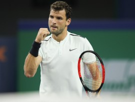 SHANGHAI, CHINA - OCTOBER 11:  Grigor Dimitrov of Bulgaria celebrates a point during the Men's singles mach against Ryan Harrison of the United States on day four of 2017 ATP Shanghai Rolex Masters at Qizhong Stadium on October 11, 2017 in Shanghai, China.  (Photo by Lintao Zhang/Getty Images)