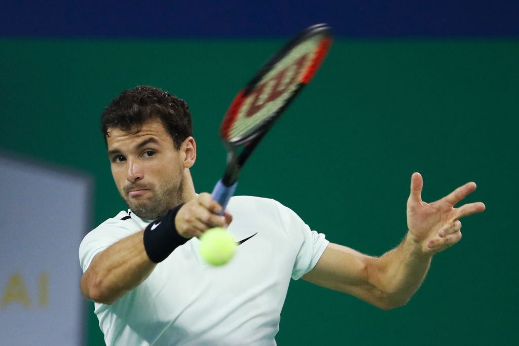 SHANGHAI, CHINA - OCTOBER 12:  Grigor Dimitrov of Bulgaria returns a shot during the Men's singles mach third round against Sam Querrey of the United States on day five of 2017 ATP Shanghai Rolex Masters at Qizhong Stadium on October 12, 2017 in Shanghai, China.  (Photo by Lintao Zhang/Getty Images)