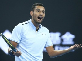 epa06252510 Nick Kyrgios of Australia reacts during his men's singles final match against Rafael Nadal of Spain at the China Open tennis tournament in Beijing, China, 08 October 2017.  EPA/WU HONG