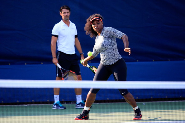 NEW YORK, NY - AUGUST 30: Serena Williams of United States, hits a ball during a practice session as her coach Patrick Mouratoglou looks on prior to the U.S. Open at USTA Billie Jean King National Tennis Center on August 30, 2015 in New York City. (Photo by Chris Trotman/Getty Images for the USTA)