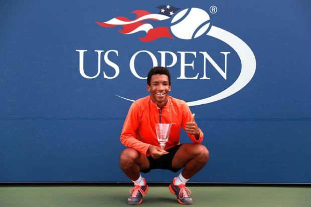NEW YORK, NY - SEPTEMBER 11:  Felix Auger-Aliassime of Canada celebrates after defeating Miomir Kecmanovic of Serbia in their Junior Boys' Singles Final Match on Day Fourteen of the 2016 US Open at the USTA Billie Jean King National Tennis Center on September 11, 2016 in the Flushing neighborhood of the Queens borough of New York City.  (Photo by Michael Reaves/Getty Images)