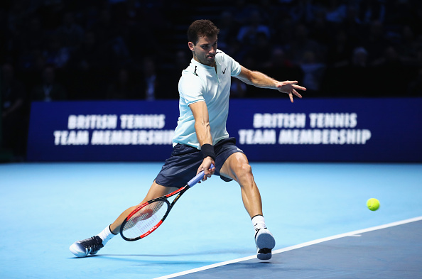 LONDON, ENGLAND - NOVEMBER 13:  Grigor Dimitrov of Bulgaria plays a forehand in his Singles match against Dominic Thiem of Austria during day two of the Nitto ATP World Tour Finals at O2 Arena on November 13, 2017 in London, England.  (Photo by Clive Brunskill/Getty Images)