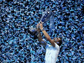 LONDON, ENGLAND - NOVEMBER 19:  Grigor Dimitrov of Bulgaria lifts the trophy as he celebrates victory following the singles final against David Goffin of Belgium during day eight of the 2017 Nitto ATP World Tour Finals at O2 Arena on November 19, 2017 in London, England.  (Photo by Linnea Rheborg/Getty Images)