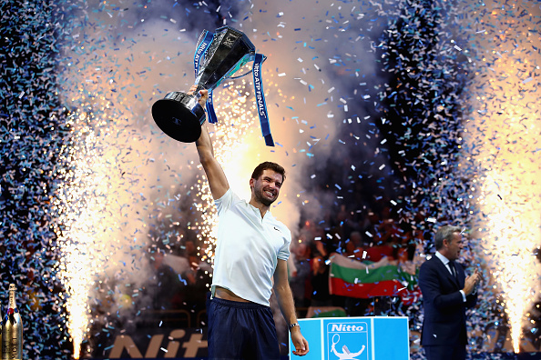 LONDON, ENGLAND - NOVEMBER 19: Grigor Dimitrov of Bulgaria lifts the trophy as he celebrates victory following the singles final against David Goffin of Belgium during day eight of the 2017 Nitto ATP World Tour Finals at O2 Arena on November 19, 2017 in London, England. (Photo by Clive Brunskill/Getty Images)
