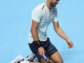 LONDON, ENGLAND - NOVEMBER 19:  Grigor Dimitrov of Bulgaria celebrates victory following the singles final against David Goffin of Belgium during day eight of the 2017 Nitto ATP World Tour Finals at O2 Arena on November 19, 2017 in London, England.  (Photo by Naomi Baker/Getty Images)