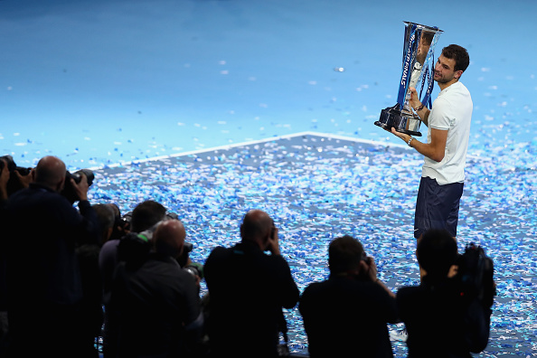 LONDON, ENGLAND - NOVEMBER 19: Grigor Dimitrov of Bulgaria lifts the trophy as he celebrates victory following the mens singles final against David Goffin of Belgium during day eight of the 2017 Nitto ATP World Tour Finals at O2 Arena on November 19, 2017 in London, England. (Photo by Naomi Baker/Getty Images)