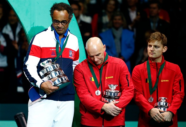 LILLE, FRANCE - NOVEMBER 26 : Yannick Noah - Johan Van Herck - team of France celebrates and Belgium - Lucas Pouille (FRA)  Steve Darcis (BEL) during the Davis Cup World Group Final match between France and Belgium on November 26, 2017 in Lille, France, 26/11/2017. (Photo by Jimmy Bolcina/Photonews  via Getty Images)