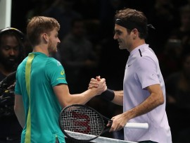 Roger Federer congratulates David Goffin after his win during day seven of the NITTO ATP World Tour Finals at the O2 Arena, London. (Photo by Adam Davy/PA Images via Getty Images)