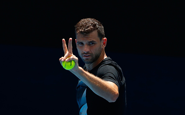 MELBOURNE, AUSTRALIA - JANUARY 10:  Grigor Dimitrov of Bulgaria gestures during a practice session ahead of the 2018 Australian Open at Melbourne Park on January 10, 2018 in Melbourne, Australia.  (Photo by Scott Barbour/Getty Images)