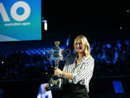 MELBOURNE, AUSTRALIA - JANUARY 11:  Maria Sharapova of Russia arrives on court with the the Daphne Akhurst Trophy during the 2018 Australian Open Official Draw at Melbourne Park on January 11, 2018 in Melbourne, Australia.  (Photo by Scott Barbour/Getty Images)
