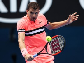 MELBOURNE, AUSTRALIA - JANUARY 15:  Grigor Dimitrov of Bulgaria plays a backhand in his first round match against Dennis Novak of Austria on day one of the 2018 Australian Open at Melbourne Park on January 15, 2018 in Melbourne, Australia.  (Photo by Cameron Spencer/Getty Images)