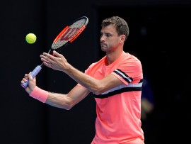 MELBOURNE, AUSTRALIA - JANUARY 15:  Grigor Dimitrov of Bulgaria serves in his first round match against Dennis Novak of Austria on day one of the 2018 Australian Open at Melbourne Park on January 15, 2018 in Melbourne, Australia.  (Photo by XIN LI/Getty Images)