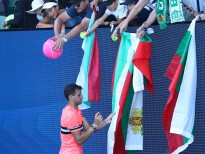 MELBOURNE, AUSTRALIA - JANUARY 15:  Grigor Dimitrov of Bulgaria signs autographs for fans after winning his first round match against Dennis Novak of Austria on day one of the 2018 Australian Open at Melbourne Park on January 15, 2018 in Melbourne, Australia.  (Photo by Cameron Spencer/Getty Images)