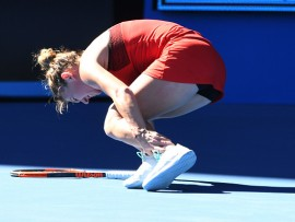 MELBOURNE, AUSTRALIA - JANUARY 16:  Simona Halep of Romania struggles after injuring her ankle in her first round match against  Destanee Aiava of Australia on day two of the 2018 Australian Open at Melbourne Park on January 16, 2018 in Melbourne, Australia.  (Photo by Quinn Rooney/Getty Images)