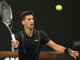 MELBOURNE, AUSTRALIA - JANUARY 20:  Novak Djokovic of Serbia plays a forehand in his third round match against Albert Ramos-Vinolas of Spain on day six of the 2018 Australian Open at Melbourne Park on January 20, 2018 in Melbourne, Australia.  (Photo by Pat Scala/Getty Images)