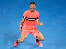 MELBOURNE, AUSTRALIA - JANUARY 21:  Grigor Dimitrov of Bulgaria celebrates match point in his fourth round match against Nick Kyrgios of Australia on day seven of the 2018 Australian Open at Melbourne Park on January 21, 2018 in Melbourne, Australia.  (Photo by Darrian Traynor/Getty Images)