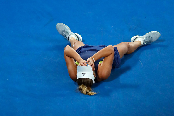 MELBOURNE, AUSTRALIA - JANUARY 27: Caroline Wozniacki of Denmark reacts after winning championship point in her women's singles final against Simona Halep of Romania on day 13 of the 2018 Australian Open at Melbourne Park on January 27, 2018 in Melbourne, Australia. (Photo by Darrian Traynor/Getty Images)