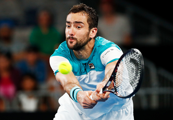 MELBOURNE, AUSTRALIA - JANUARY 19:  Marin Cilic of Croatia plays a forehand in his third round match against Ryan Harrison of the USA on day five of the 2018 Australian Open at Melbourne Park on January 19, 2018 in Melbourne, Australia.  (Photo by Michael Dodge/Getty Images)