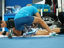 MELBOURNE, AUSTRALIA - JANUARY 20:  Novak Djokovic of Serbia receives medical treatment in his third round match against Albert Ramos-Vinolas of Spain on day six of the 2018 Australian Open at Melbourne Park on January 20, 2018 in Melbourne, Australia.  (Photo by Pat Scala/Getty Images)