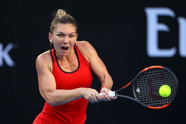 MELBOURNE, AUSTRALIA - JANUARY 18:  Simona Halep of Romania plays a backhand in her second round match against Eugenie Bouchard of Canada on day four of the 2018 Australian Open at Melbourne Park on January 18, 2018 in Melbourne, Australia.  (Photo by Mark Kolbe/Getty Images)