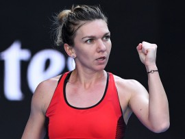 MELBOURNE, AUSTRALIA - JANUARY 22:  Simona Halep of Romania celebrates winning a point in her fourth round match against Naomi Osaka of Japan on day eight of the 2018 Australian Open at Melbourne Park on January 22, 2018 in Melbourne, Australia.  (Photo by Quinn Rooney/Getty Images)
