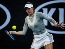MELBOURNE, VIC - JANUARY 16: Garbine Mugurza of Spain plays a shot in her first round match during the 2018 Australian Open on January 16, 2018, at Melbourne Park Tennis Centre in Melbourne, Australia.(Photo by Jason Heidrich/Icon Sportswire via Getty Images)