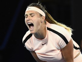 MELBOURNE, AUSTRALIA - JANUARY 16:  Aryna Sabalenka of Belarus reacts after missing a point in her first round match against Ashleigh Barty of Australia on day two of the 2018 Australian Open at Melbourne Park on January 16, 2018 in Melbourne, Australia.  (Photo by Quinn Rooney/Getty Images)