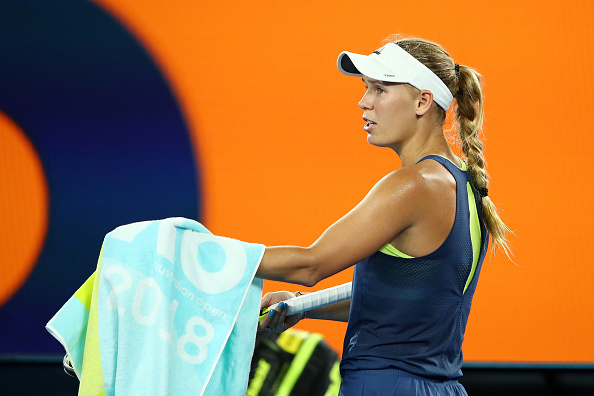 MELBOURNE, AUSTRALIA - JANUARY 19:  Caroline Wozniacki of Denmark complains to the umpire about water on the court in her third round match against Kiki Bertens of the Netherlands on day five of the 2018 Australian Open at Melbourne Park on January 19, 2018 in Melbourne, Australia.  (Photo by Cameron Spencer/Getty Images)