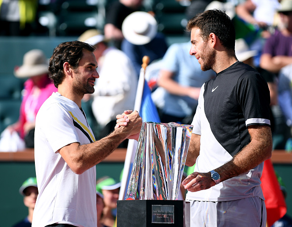 INDIAN WELLS, CA - MARCH 18:  Juan Martin Del Potro of Argentina shakes hands with Roger Federer of Switzerland at the trophy presentation after a three set victory in the ATP final during the BNP Paribas Open at the Indian Wells Tennis Garden on March 18, 2018 in Indian Wells, California.  (Photo by Harry How/Getty Images)