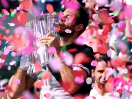 INDIAN WELLS, CA - MARCH 18:  Juan Martin Del Potro of Argentina holds up the trophy in front of Roger Federer of Switzerland after his victory in the ATP final during the BNP Paribas Open at the Indian Wells Tennis Garden on March 18, 2018 in Indian Wells, California.  (Photo by Harry How/Getty Images)