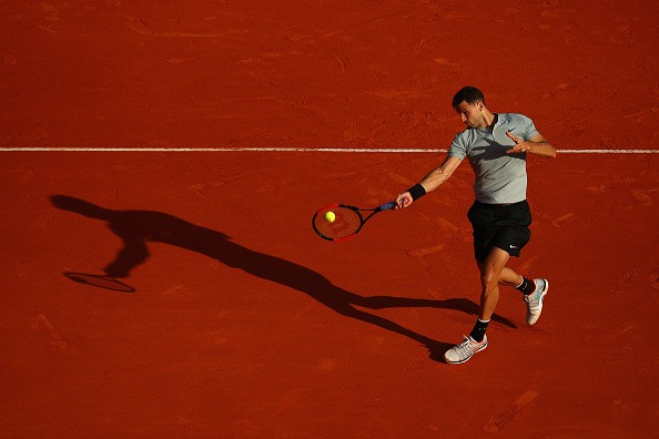 MONTE-CARLO, MONACO - APRIL 17:  Grigor Dimitrov of Bulgaria plays a forehand in his match against Pierre-Hugues Herbert of France during Day Three of the ATP Masters Series Monte Carlo Rolex Masters at Monte-Carlo Sporting Club on April 17, 2018 in Monte-Carlo, Monaco.  (Photo by Julian Finney/Getty Images)