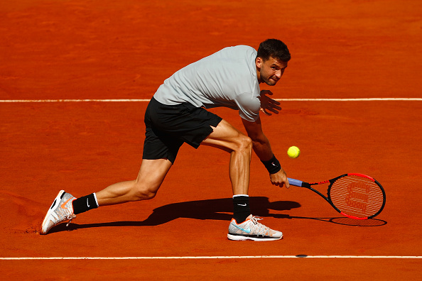 MONTE-CARLO, MONACO - APRIL 20:  Grigor Dimitrov of Bulgaria in action in his singles match against David Goffin of Belgium during say six of ATP Masters Series: Monte Carlo Rolex Masters at Monte-Carlo Sporting Club on April 20, 2018 in Monte-Carlo, Monaco.  (Photo by Julian Finney/Getty Images)