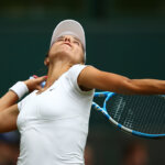 LONDON, ENGLAND - JULY 04:  Viktoriya Tomova of Bulgaria serves against Serena Williams of The United States during their Ladies' Singles second round match on day three of the Wimbledon Lawn Tennis Championships at All England Lawn Tennis and Croquet Club on July 4, 2018 in London, England.  (Photo by Clive Mason/Getty Images)