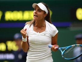 LONDON, ENGLAND - JULY 04:  Viktoriya Tomova of Bulgaria celebrates a point against Serena Williams of The United States during their Ladies' Singles second round match on day three of the Wimbledon Lawn Tennis Championships at All England Lawn Tennis and Croquet Club on July 4, 2018 in London, England.  (Photo by Clive Mason/Getty Images)