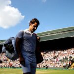 LONDON, ENGLAND - JULY 11:  Roger Federer of Switzerland walks off No.1 court after losing his Men's Singles Quarter-Finals match against Kevin Anderson of South Africa on day nine of the Wimbledon Lawn Tennis Championships at All England Lawn Tennis and Croquet Club on July 11, 2018 in London, England. Anderson won the match 6-4, 7-6, 5-7, 4-6, 11-13 in 4hr 13min.  (Photo by Julian Finney/Getty Images)