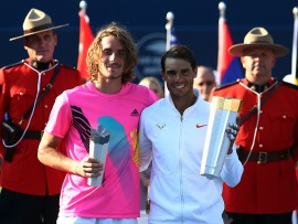 TORONTO, ON - AUGUST 12:  Rafael Nadal (R) of Spain with the champions trophy following his win in the final match against Stefanos Tsitsipas (L) of Greece on Day 7 of the Rogers Cup at Aviva Centre on August 12, 2018 in Toronto, Canada.  (Photo by Vaughn Ridley/Getty Images)