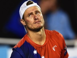 epa05115964 Lleyton Hewitt of Australia reacts after his second round match against David Ferrer of Spain at the Australian Open Grand Slam tennis tournament in Melbourne, Australia, 21 January 2016.  EPA/TRACEY NEARMY AUSTRALIA AND NEW ZEALAND OUT