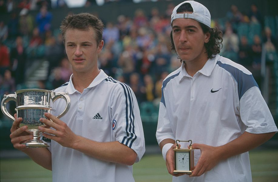 Todd Reid of Australia (left) holds the trophy after defeating Lamine Ouahab of Algeria (right) in the final of the boy's singles tennis tournament at the Wimbledon Lawn Tennis Championships at the All England Lawn Tennis Club in Wimbledon, London in July 2002. (Photo by Professional Sport/Popperfoto/Getty Images)