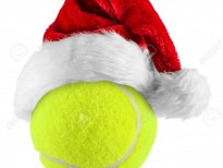 santa hat on tennis ball on white background